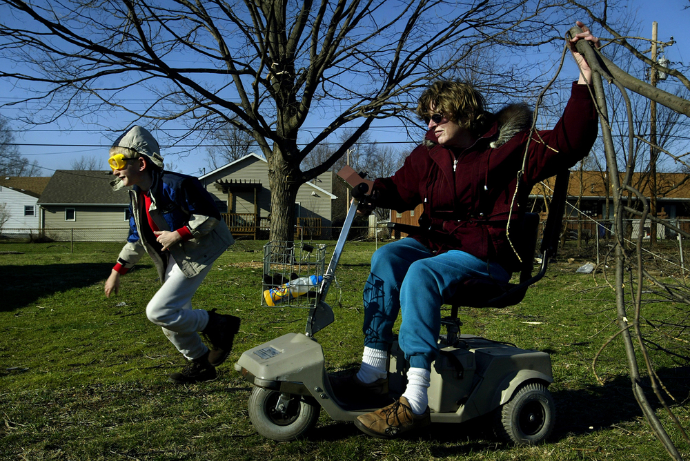 Jordan Magner, 8, assists his mom, Shelby Magner, with moving downed branches from their backyard to the front of their home on Jerome Avenue on Tuesday, March 14, 2006. File/Jonathan Kirshner/The State Journal-Register