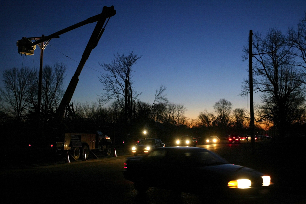 Crews continue repair work on tornado-damaged power lines along Laurel Street Tuesday, March 14, 2006. File/Jonathan Kirshner/The State Journal-Register