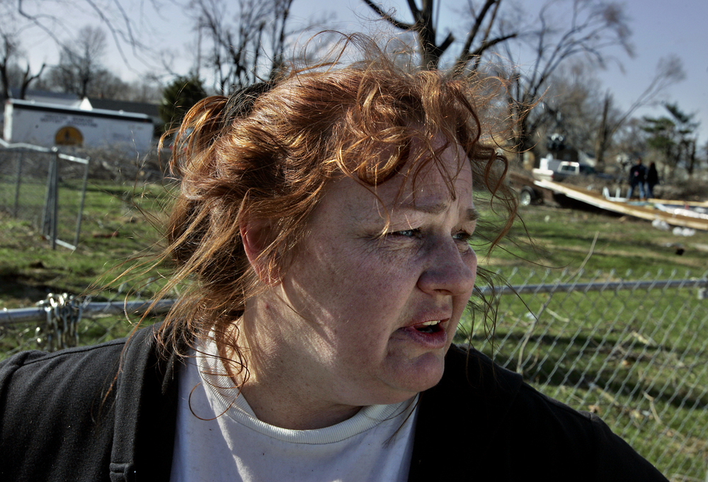 Terri Falzone assesses the damage to her East Cedar Street home Tuesday, March 14. File/T.J. Salsman/The State Journal-Register