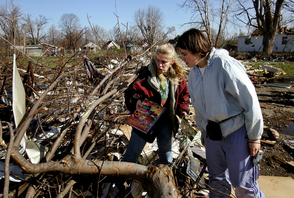 Tammy Williams, left, and Rachel Williams try to find personal belongings in the remains of their family's home on East Cedar Street. File/The State Journal-Register