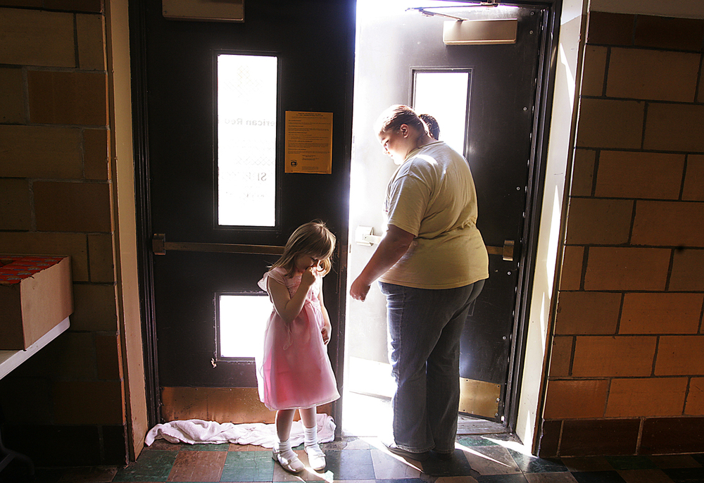 Kelly Atkison and her daughter, Amber leave the American Red Cross shelter  at Lanphier High School. The family was displaced when their home was damaged by the tornado. File/T.J. Salsman/The State Journal-Register