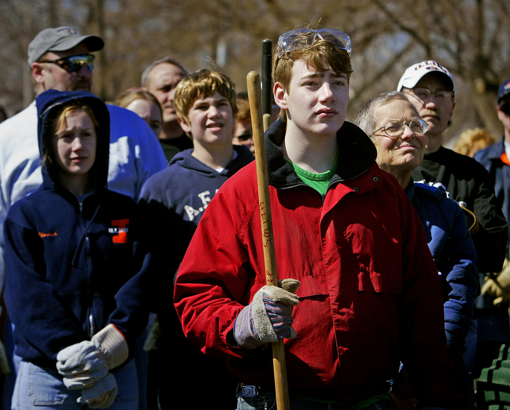Volunteers, including 16-year-old Springfield resident Jeffrey Smith (in red), listen to instructions about their storm cleanup work at the volunteer command center at Zion Baptist Church as 16th and Laurel streets. File/David Albers/The State Journal-Register