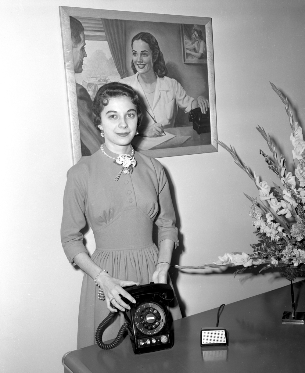 women with dial telephone; March 11, 1955