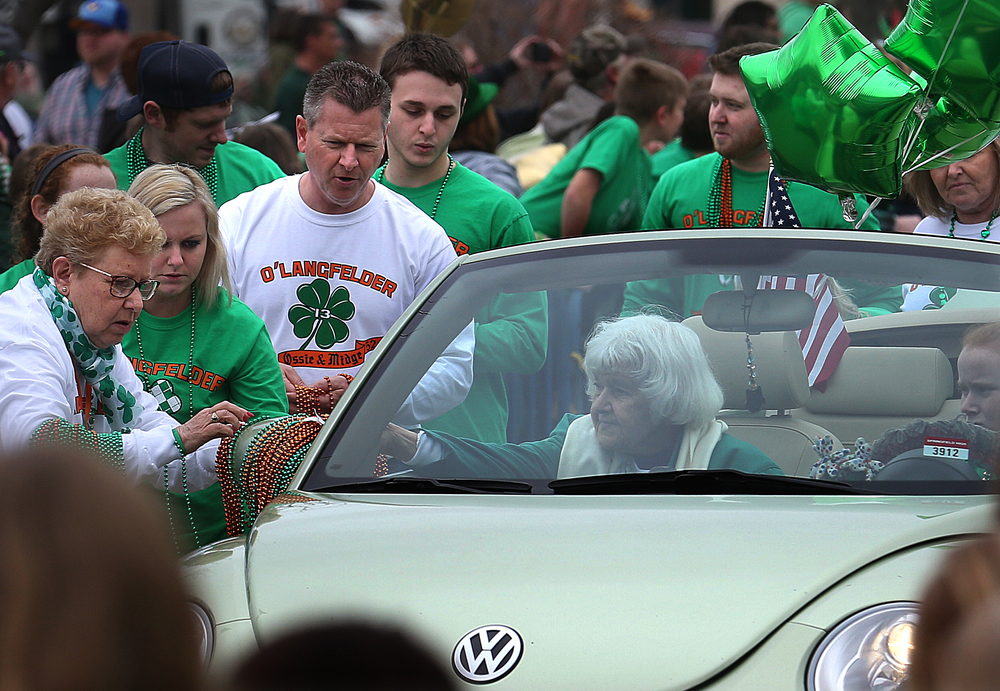 At center, Midge Langfelder, the wife of late Springfield mayor Ossie Langfelder, rode in the parade along with the extended Langfelder family-who were named parade Grand Marshals-including her son Josh Langfelder, the current Springfield mayor, and approximately 65 members of her extended family. David Spencer/The State Journal Register