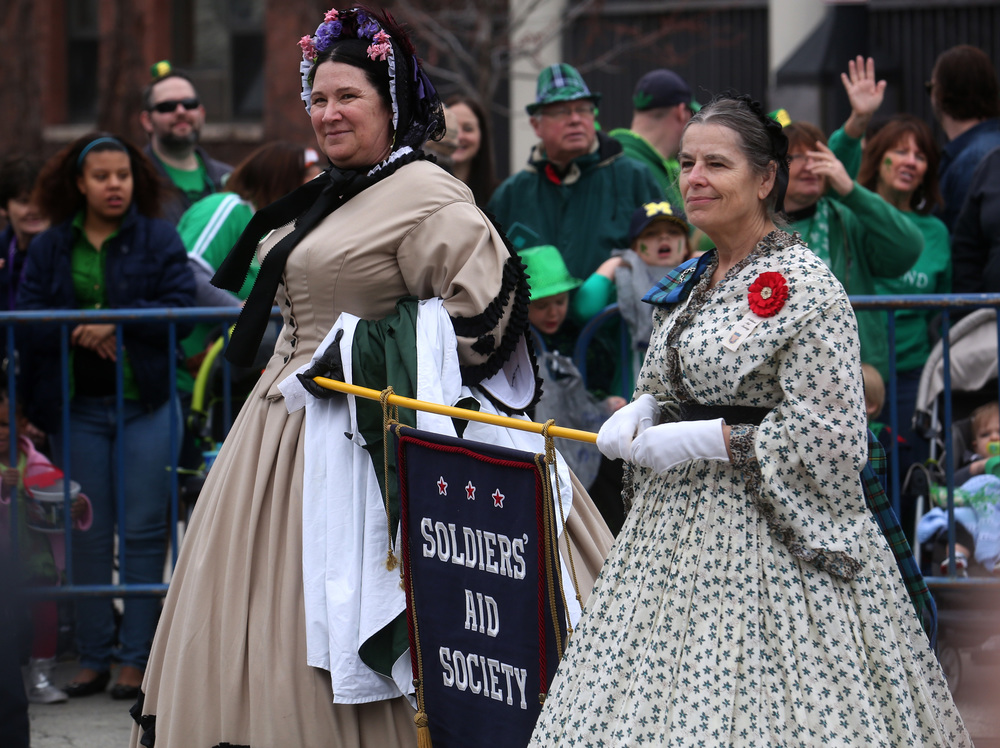 Two fashionably-dressed women with the Soldiers' Aid Society walk in the parade along Jefferson St.  David Spencer/The State Journal Register
