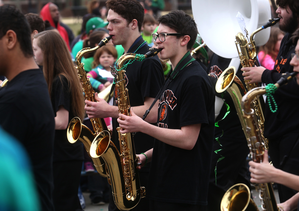 The saxaphone section of the Lanphier High School band shows off their stuff along Jefferson St. David Spencer/The State Journal Register