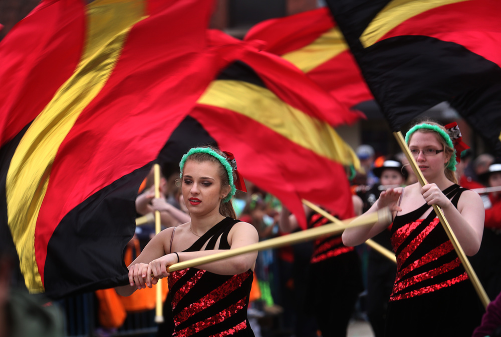 Glenwood High School color guard members twirl their flags along S. Fifth Street.  David Spencer/The State Journal Register