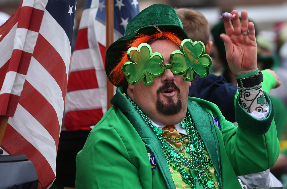 Those running for elected office were numerous along the official parade route, including support personal throwing out candy including this gentleman sporting shamrock eyewear riding on the back of a pickup truck down S. Fifth St. David Spencer/The State Journal Register