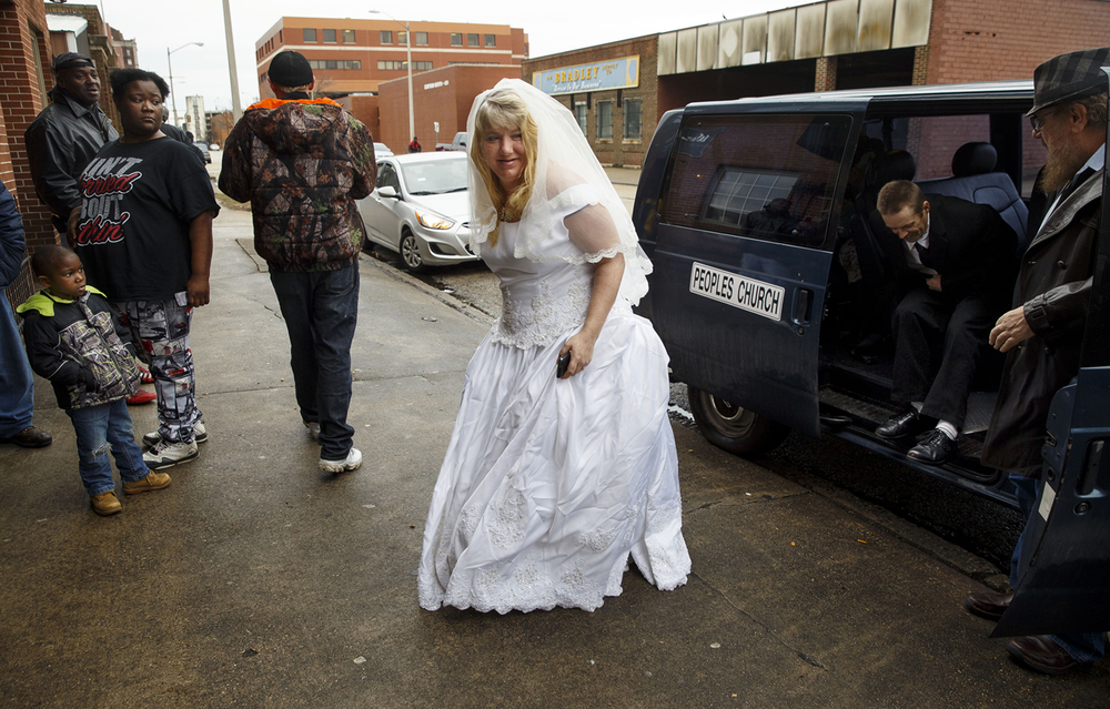 Lori Moore and Randy Karrick exit the Peoples Church van after arriving at Washington Street Mission for their wedding ceremony Monday, March 7, 2016. Karrick and More, who was president of Homeless United for Change, an advocacy group led in part by people who have been homeless in the past, struggled through homelessness together and now have a home. The couple wanted to be married among their community of friends. Ted Schurter/The State Journal-Register