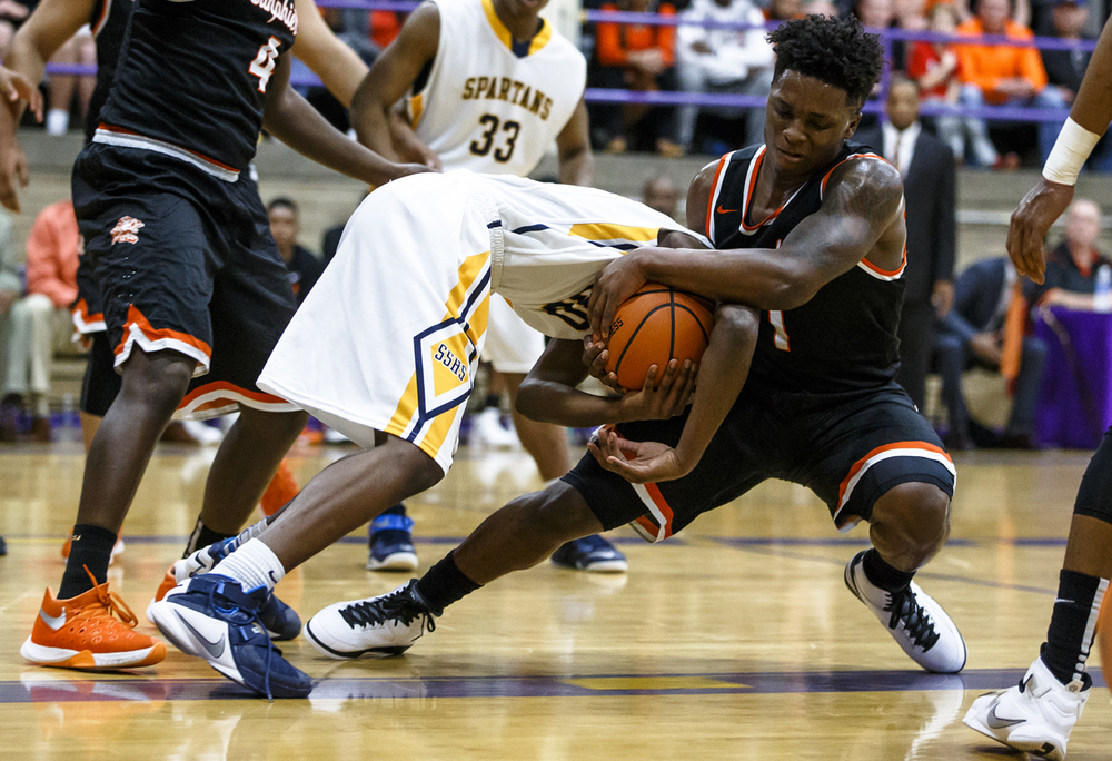 Lanphier's Yaakema Rose (1) and Southeast's D'Angelo Hughes (30) tangle for a loose ball in the first quarter during the Class 3A Taylorville Sectional championship at Dolph Stanley Court, Friday, March 11, 2016, in Taylorville, Ill. Justin L. Fowler/The State Journal-Register