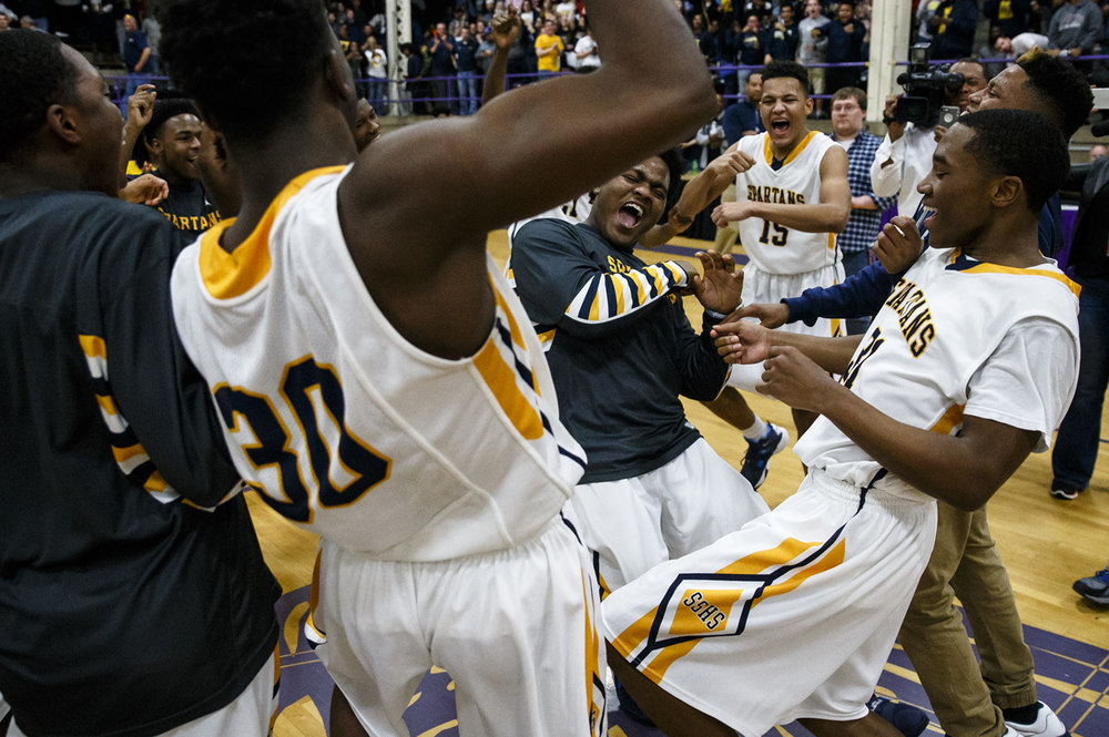 Southeast's Andre Booker, center, dances with the team as the Spartans celebrate their 62-57 victory over Lanphier in the Class 3A Taylorville Sectional championship at Dolph Stanley Court, Friday, March 11, 2016, in Taylorville, Ill. Justin L. Fowler/The State Journal-Register