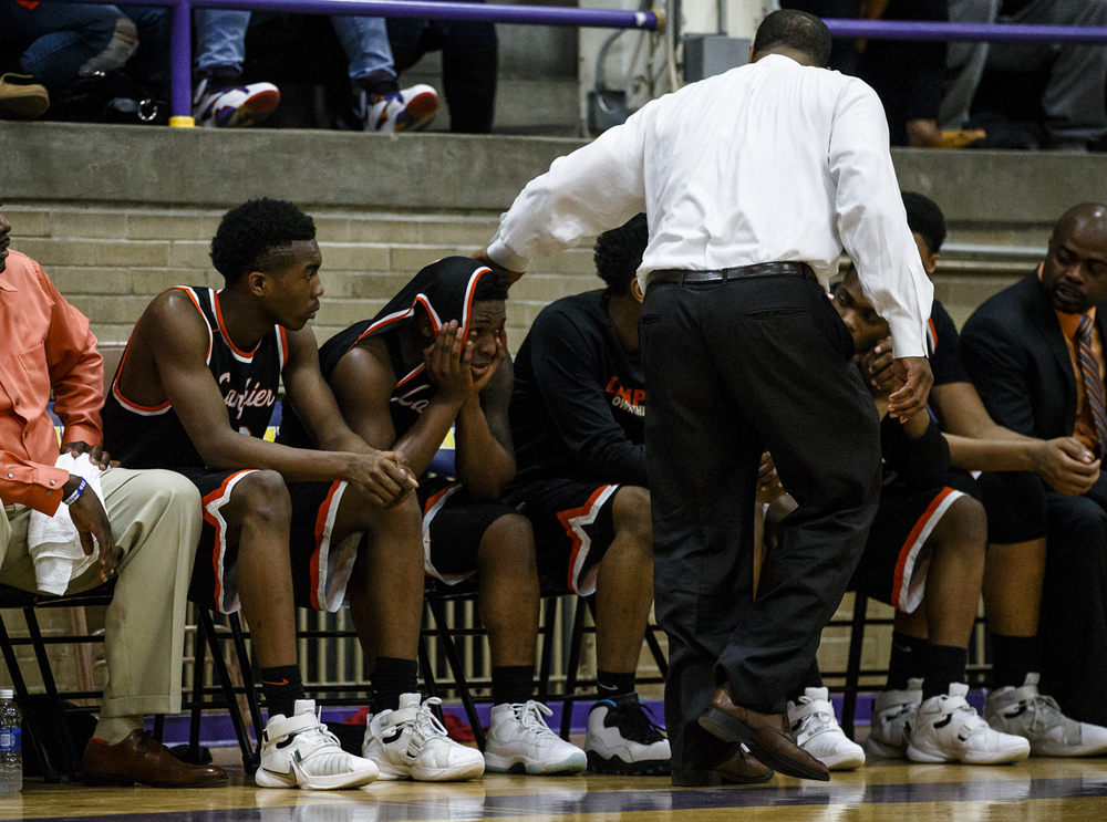 Lanphier head basketball coach Blake Turner comes over to talk with Lanphier's Yaakema Rose (1) after he fouled out of the game against Southeast in the fourth quarter during the Class 3A Taylorville Sectional championship at Dolph Stanley Court, Friday, March 11, 2016, in Taylorville, Ill. Justin L. Fowler/The State Journal-Register