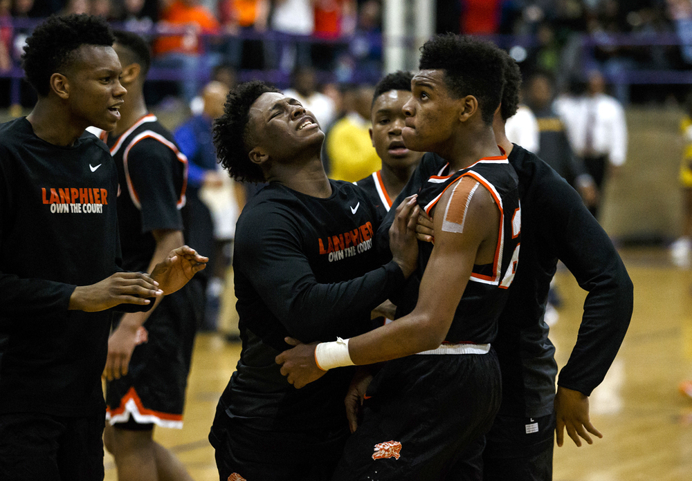 Lanphier's Aundrae Williams (23) gets shoved by Lanphier's Yaakema Rose (1) after hitting a three against Southeast late in the fourth quarter during the Class 3A Taylorville Sectional championship at Dolph Stanley Court, Friday, March 11, 2016, in Taylorville, Ill. Justin L. Fowler/The State Journal-Register