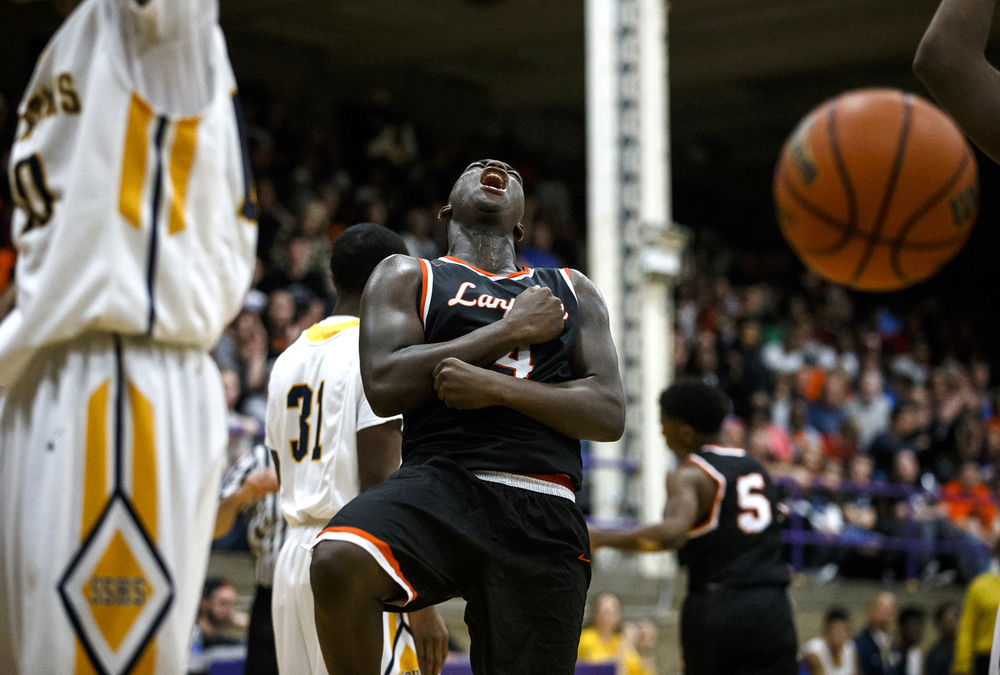 Lanphier's Corrington Jones (4) reacts after drawing a foul while shooting against Southeast in the fourth quarter during the Class 3A Taylorville Sectional championship at Dolph Stanley Court, Friday, March 11, 2016, in Taylorville, Ill. Justin L. Fowler/The State Journal-Register