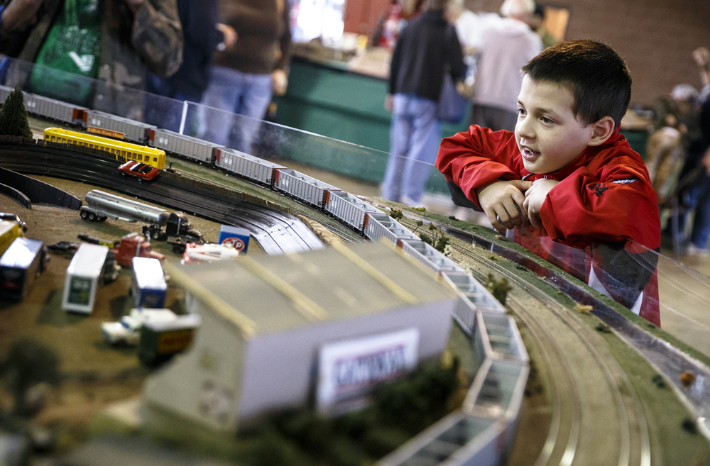 Jordan Furr, 10, of Chatham Ill., takes in the train display from the New Switzerland Model Railroad Club that included a replicated Gateway International Speedway with race cars during the Springfield Railroad Society Train Fair at the Orr Building on the Illinois State Fairgrounds, Sunday, March 13, 2016, in Springfield, Ill. Justin L. Fowler/The State Journal-Register