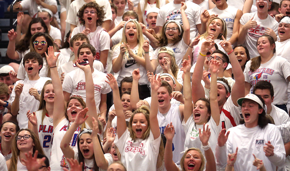The Pleasant Plains student cheering section shows their spirit Tuesday night. St. Joseph-Ogden defeated Pleasant Plains 56-43 to claim the 2A Supersectional boys basketball title game at the University of Illinois Springfield TRAC center on Tuesday evening, March 8, 2016. David Spencer/The State Journal Register