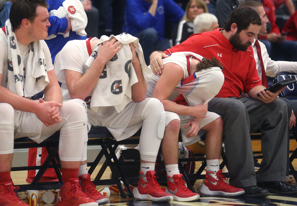 Pleasant Plains starters from left to right finish out the game dejected on the bench: Nik Clemens, Austin Finley, Cole Greer. St. Joseph-Ogden defeated Pleasant Plains 56-43 to claim the 2A Supersectional boys basketball title game at the University of Illinois Springfield TRAC center on Tuesday evening, March 8, 2016. David Spencer/The State Journal Register