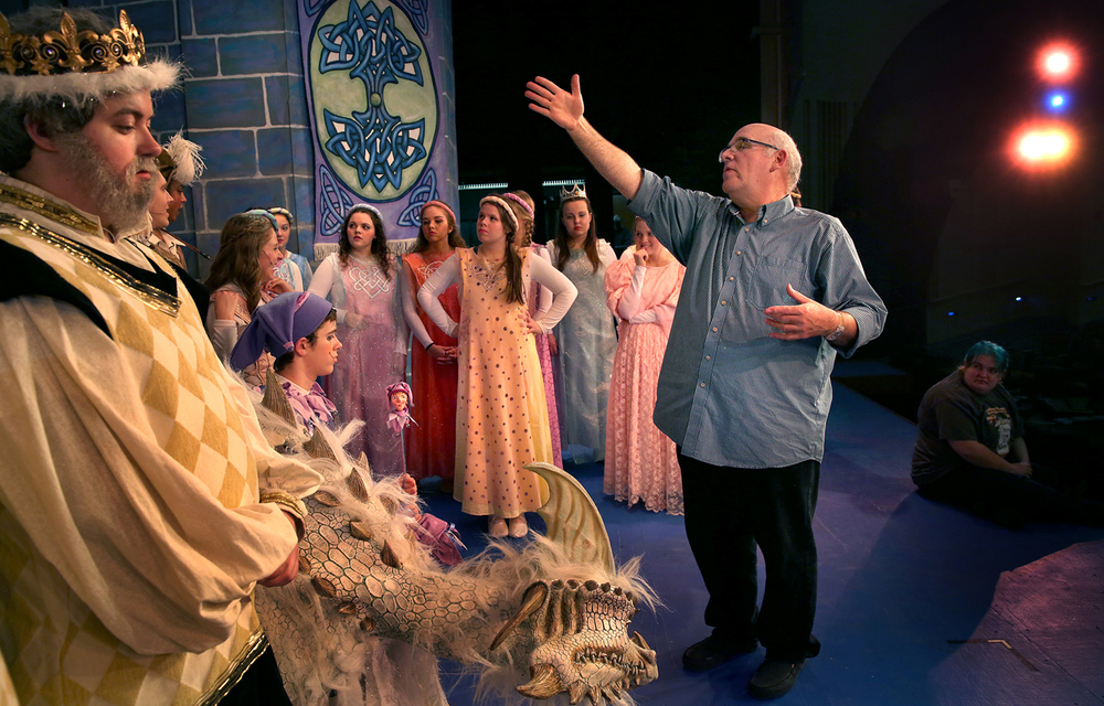 David Shaw organizes student cast members for an official photo of the school's production of the musical comedy Once Upon a Mattress in the school auditorium on Wednesday, March 9, 2016. Rochester High School art teacher and theatre director David Shaw is retiring at the end of the school year. David Spencer/The State Journal Register