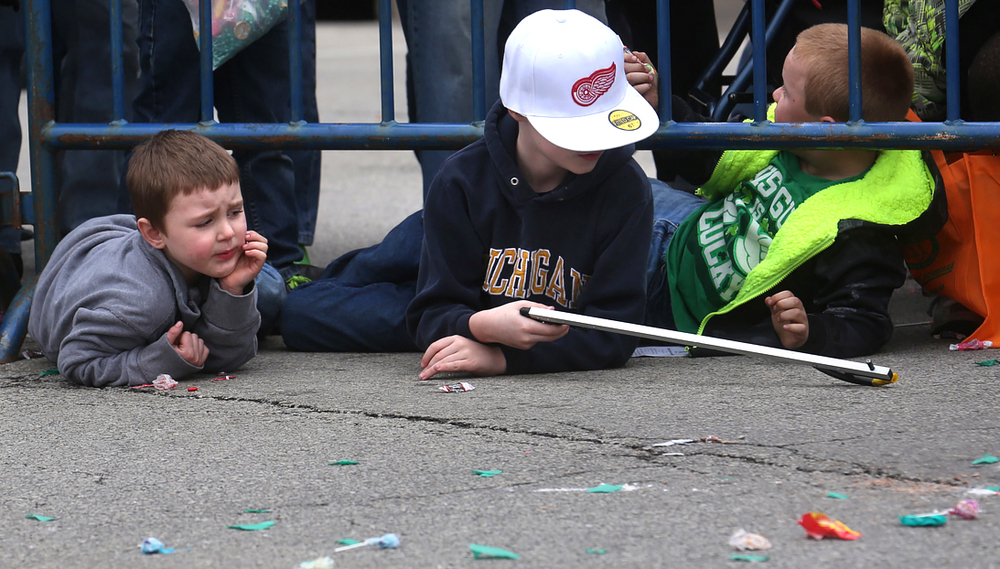 A boy came equipped with a reaching aid to snag candy that landed out of arms reach along the route of the St. Patrick's Marching Band Parade Saturday, March 13, 2016. David Spencer/The State Journal Register