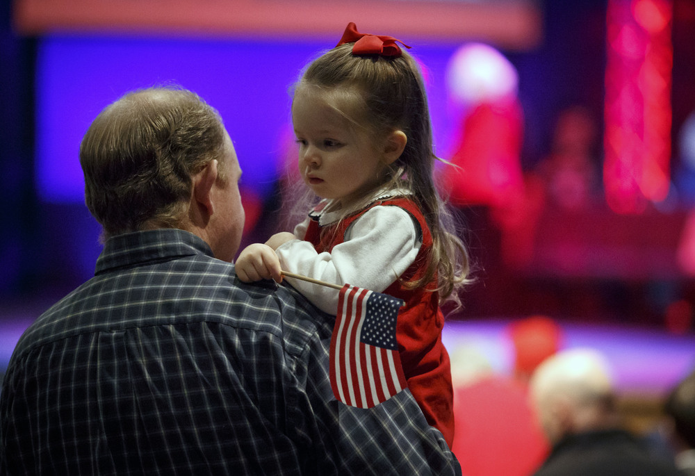 Mary Siena Jones, 3, of Pleasant Plains, Ill., has an American Flag at the ready prior to Republican presidential candidate, Sen. Ted Cruz, R-Texas, taking the stage for a campaign rally at the iWorship Center, Monday, March 14, 2016, in Springfield, Ill. Cruz finished the last of his five stops across Illinois in Springfield the day before the primary. Justin L. Fowler/The State Journal-Register
