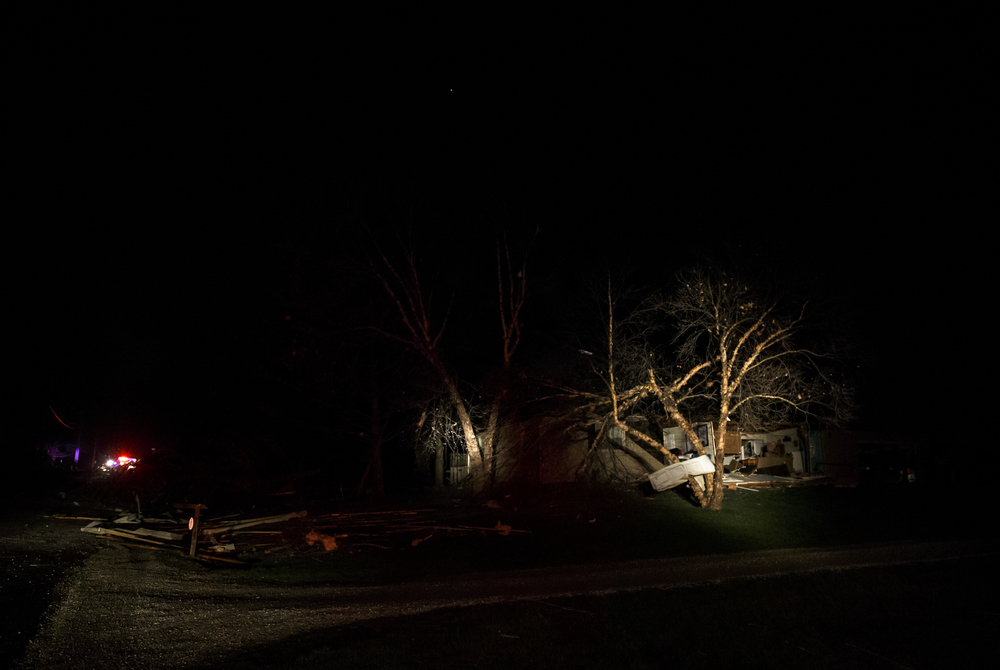 The scene of a structure in the 6300 block of West Iles Avenue that was hit by a suspected tornado is illuminated by the spotlights from a firetruck, Tuesday, March 15, 2016, in Springfield, Ill. Justin L. Fowler/The State Journal-Register
