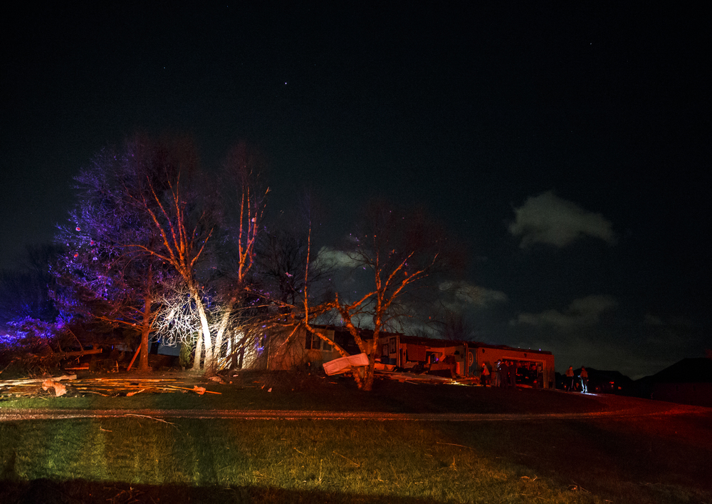 The scene of a structure in the 6300 block of West Iles Avenue is illuminated by lights from emergency vehicles after a suspected tornado hit, Tuesday, March 15, 2016, in Springfield, Ill. Justin L. Fowler/The State Journal-Register