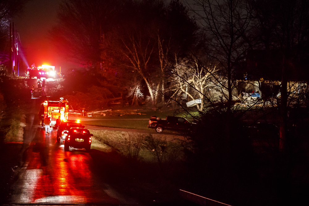 Emergency personnel line West Iles Avenue as they respond to a structure in the 6300 block of West Iles Avenue that was hit by a suspected tornado, Tuesday, March 15, 2016, in Springfield, Ill. Justin L. Fowler/The State Journal-Register