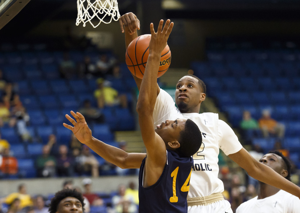 Belleville Althoff's Brendon Gooch (22) blocks a shot from Southeast's Trevyon Williams (14) in the fourth quarter during the Class 3A Springfield Supersectional at the Prairie Capital Convention Center, Tuesday, March 15, 2016, in Springfield, Ill. Justin L. Fowler/The State Journal-Register