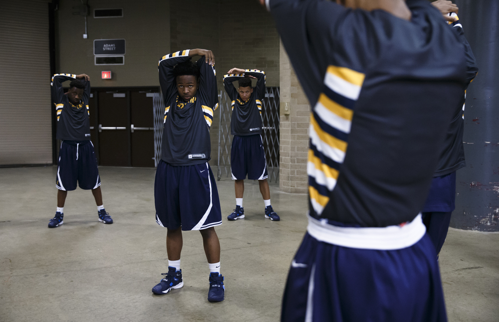 The Southeast Spartans get warmed up prior to taking on Belleville Althoff in the Class 3A Springfield Supersectional at the Prairie Capital Convention Center, Tuesday, March 15, 2016, in Springfield, Ill. Justin L. Fowler/The State Journal-Register