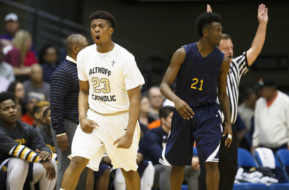 Belleville Althoff's Jordan Goodwin (23) reacts after hitting a three against Southeast's Anthony Fairlee (21) in the second quarter during the Class 3A Springfield Supersectional at the Prairie Capital Convention Center, Tuesday, March 15, 2016, in Springfield, Ill. Justin L. Fowler/The State Journal-Register