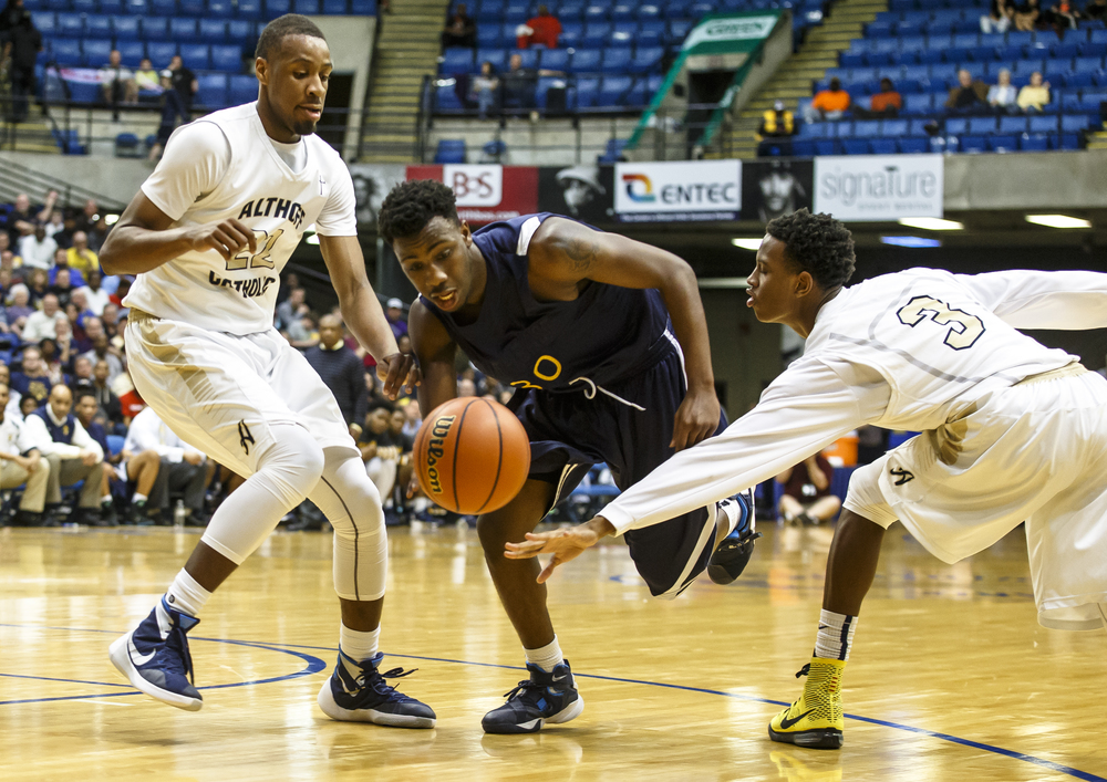 Southeast's D'Angelo Hughes (30) has the ball knocked away by Belleville Althoff's Edwyn Brown (3) in the first quarter during the Class 3A Springfield Supersectional at the Prairie Capital Convention Center, Tuesday, March 15, 2016, in Springfield, Ill. Justin L. Fowler/The State Journal-Register