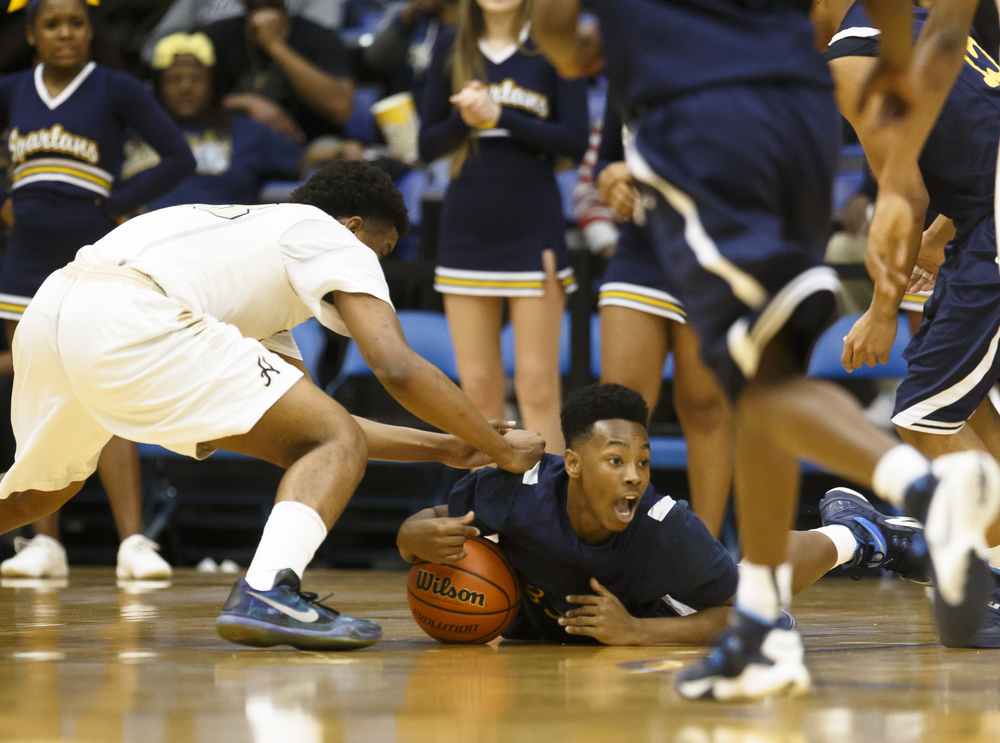 Southeast's Mark Johnson (33) tries to recover a loose ball on the floor against Belleville Althoff in the second quarter during the Class 3A Springfield Supersectional at the Prairie Capital Convention Center, Tuesday, March 15, 2016, in Springfield, Ill. Justin L. Fowler/The State Journal-Register