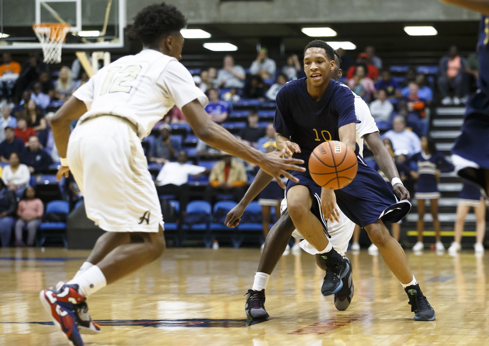 Southeast's Isaiah Walton (10) has the ball knocked away from behind by Belleville Althoff's Tarkus Ferguson (4) in the second quarter during the Class 3A Springfield Supersectional at the Prairie Capital Convention Center, Tuesday, March 15, 2016, in Springfield, Ill. Justin L. Fowler/The State Journal-Register