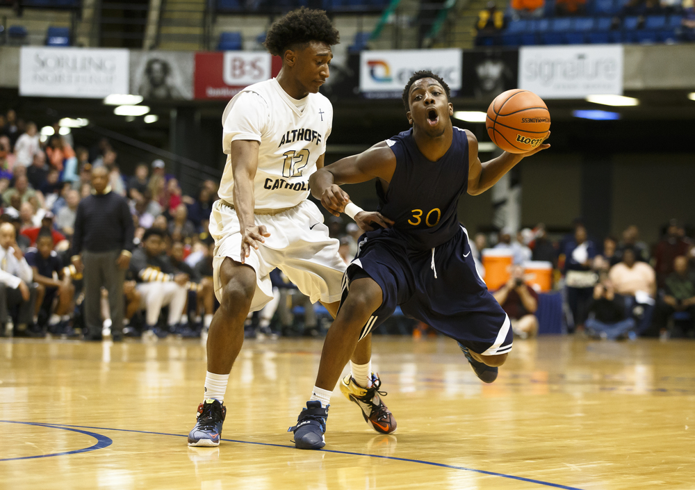 Southeast's D'Angelo Hughes (30) drives the ball towards the basket against Belleville Althoff's CJ Coldon (12) in the second quarter during the Class 3A Springfield Supersectional at the Prairie Capital Convention Center, Tuesday, March 15, 2016, in Springfield, Ill. Justin L. Fowler/The State Journal-Register