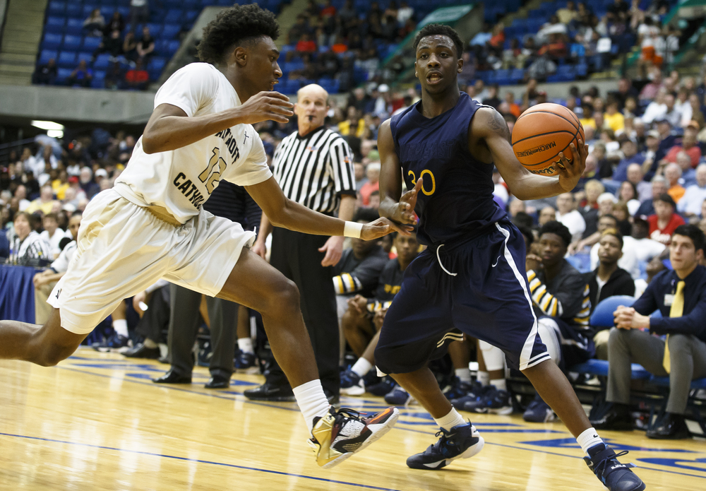 Southeast's D'Angelo Hughes (30) starts to spin around Belleville Althoff's CJ Coldon (12) in the third quarter during the Class 3A Springfield Supersectional at the Prairie Capital Convention Center, Tuesday, March 15, 2016, in Springfield, Ill. Justin L. Fowler/The State Journal-Register