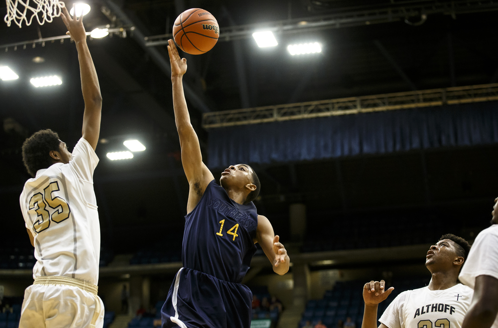 Southeast's Trevyon Williams (14) goes up for an attempt against Belleville Althoff's Marvin Bateman (35) in the third quarter during the Class 3A Springfield Supersectional at the Prairie Capital Convention Center, Tuesday, March 15, 2016, in Springfield, Ill. Justin L. Fowler/The State Journal-Register