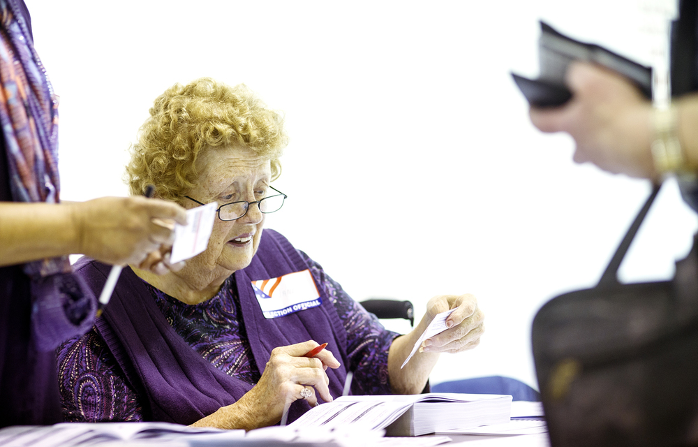 Election judge Janet Welch examines a voter registration card at the Grandview Municipal Building Tuesday, March 15, 2016. Ted Schurter/The State Journal-Register
