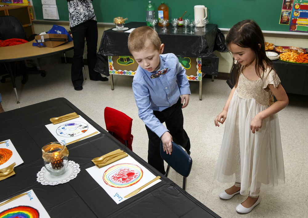 Brody Watson pulls a chair out for classmate Leah Pauly during the St. Agnes Kindergarten Elegant Event, Wednesday, March 16, 2016. Students wore their most elegant clothing as they practiced their table manners, math and money skills, and waltzing. Ted Schurter/The State Journal-Register