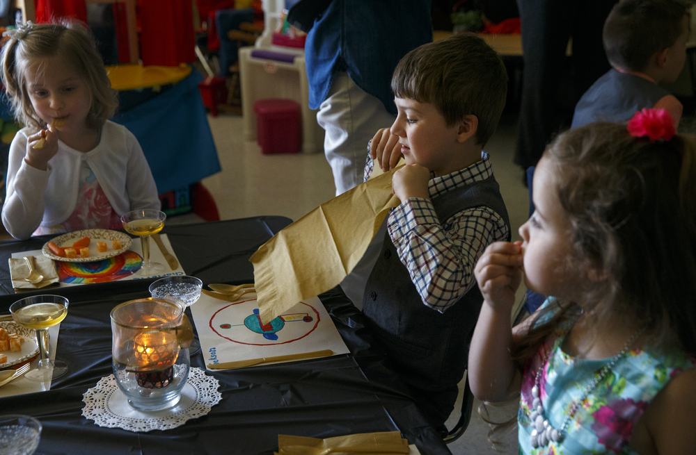 Jackson Ihlenfeldt shakes his napkin out as he prepares to begin his meal during the St. Agnes Kindergarten Elegant Event, Wednesday, March 16, 2016. Students wore their most elegant clothing as they practiced their table manners, math and money skills, and waltzing. Ted Schurter/The State Journal-Register