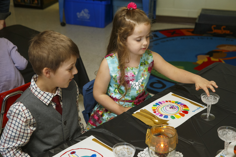 Charlotte Alderman dips her finger into her bubbly drink during the St. Agnes Kindergarten Elegant Event, Wednesday, March 16, 2016. Students wore their most elegant clothing as they practiced their table manners, math and money skills, and waltzing. Ted Schurter/The State Journal-Register