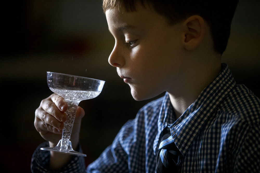 Max Harrison inspects his bubbly drink before taking a sip during the St. Agnes Kindergarten Elegant Event, Wednesday, March 16, 2016. Students wore their most elegant clothing as they practiced their table manners, math and money skills, and waltzing. Ted Schurter/The State Journal-Register