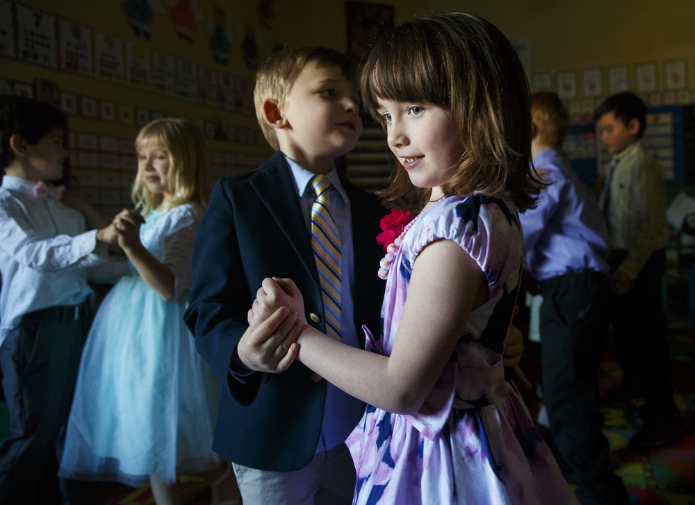 Amelia Knappmeyer dances with Brody Lyons during the St. Agnes Kindergarten Elegant Event, Wednesday, March 16, 2016. Students wore their most elegant clothing as they practiced their table manners, math and money skills, and waltzing. Ted Schurter/The State Journal-Register
