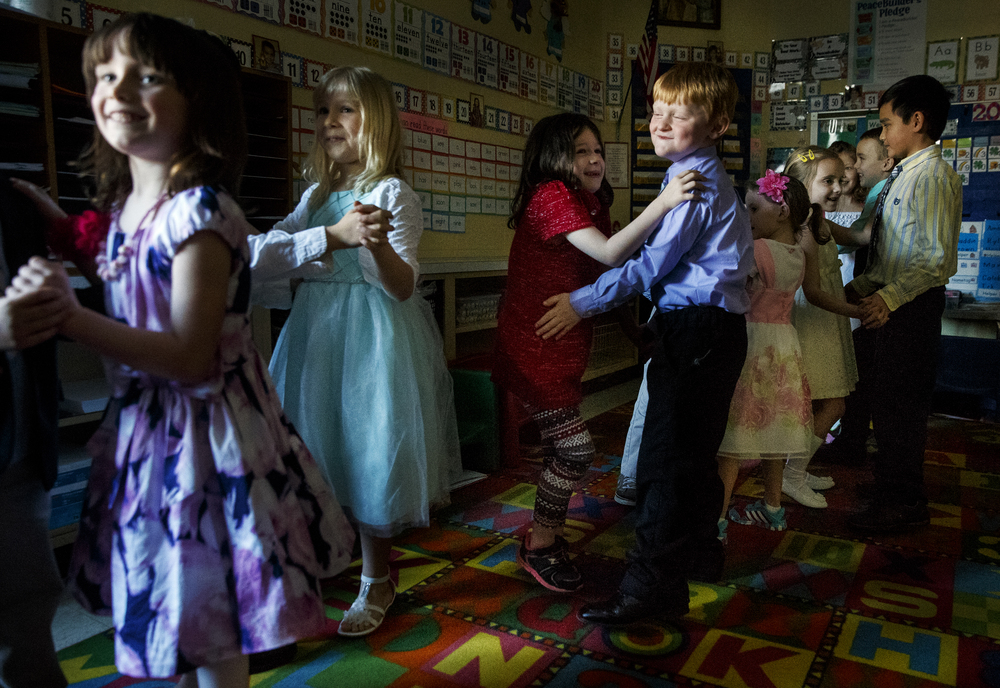Justin Canny dances with Maddie Brown during the St. Agnes Kindergarten Elegant Event, Wednesday, March 16, 2016. Students wore their most elegant clothing as they practiced their table manners, math and money skills, and waltzing. Ted Schurter/The State Journal-Register