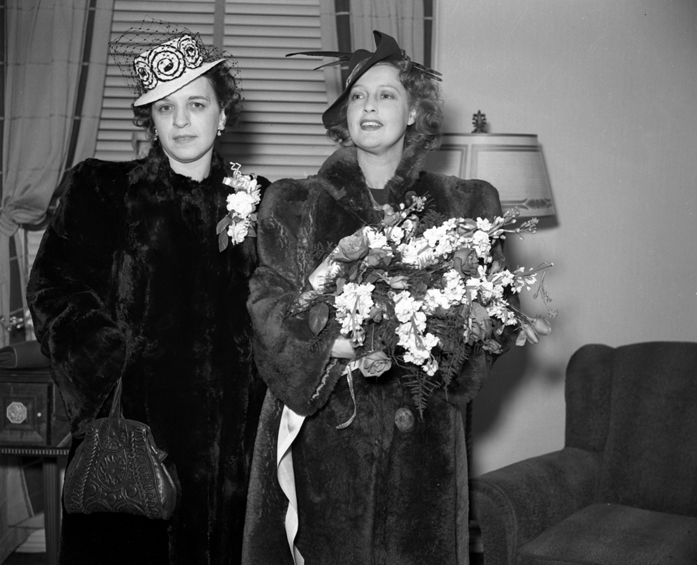 Mrs. M. E. Berman, left,  presented Jeanettte MacDonald with a bouquet of flowers when she arrived at the Alton station March 19, 1940. Berman was the wife of the Orpheum Theater manager, who could not be present for MacDonald's arrival. file/The State Journal-Register