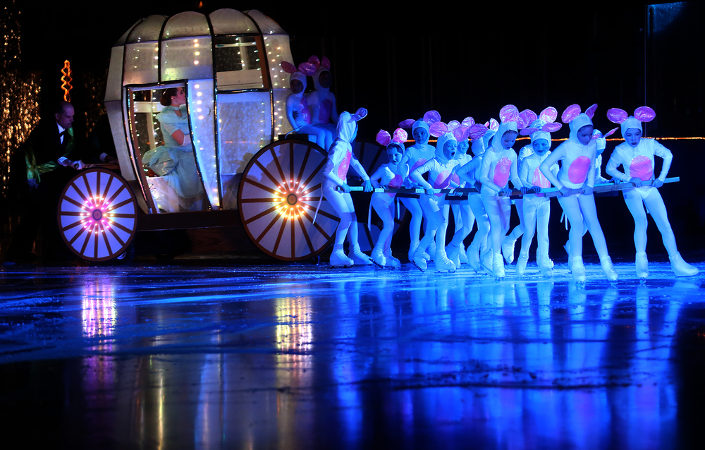 With Cinderella inside played by skater Bailey Manuel, a team of mouse skaters pull her carriage over the ice during Saturday's matinee performance of Spotlight on Ice. David Spencer/The State Journal Register