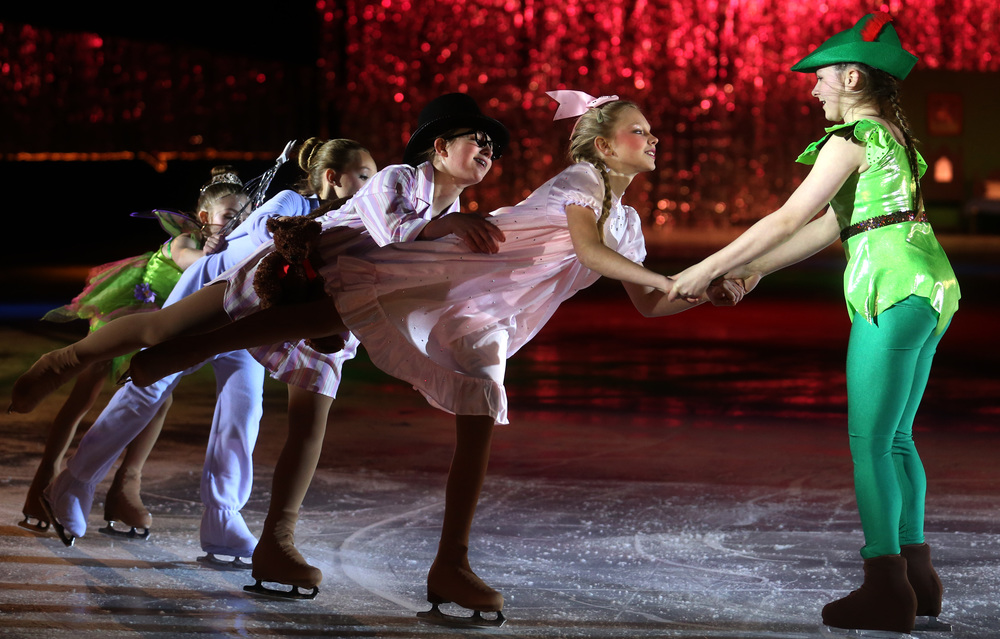 Peter Pan performed by skater Paige Zolnierek at far right leads a group of skaters at Saturday's matinee performance. David Spencer/The State Journal Register