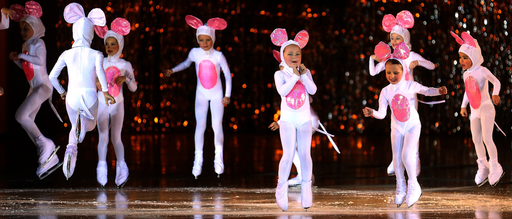 During the Cinderella segment, some of the young mouse performers jump up on the ice. David Spencer/The State Journal Register