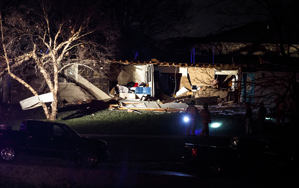 The exterior wall of a structure in the 6300 block of West Iles Avenue was completely ripped off after being hit by a suspected tornado, Tuesday, March 15, 2016, in Springfield, Ill. Justin L. Fowler/The State Journal-Register