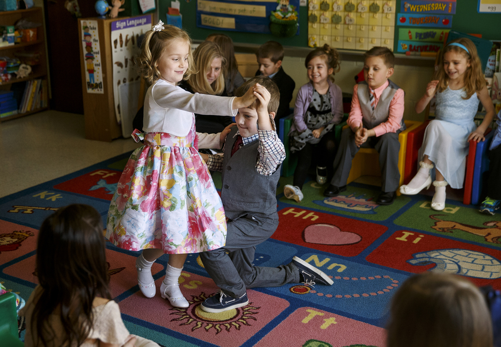 Josephine Young is spun around by Jackson Ihlenfeldt as they dance during the St. Agnes Kindergarten Elegant Event, Wednesday, March 16, 2016. Students wore their most elegant clothing as they practiced their table manners, math and money skills, and waltzing.  Ted Schurter/The State Journal-Register