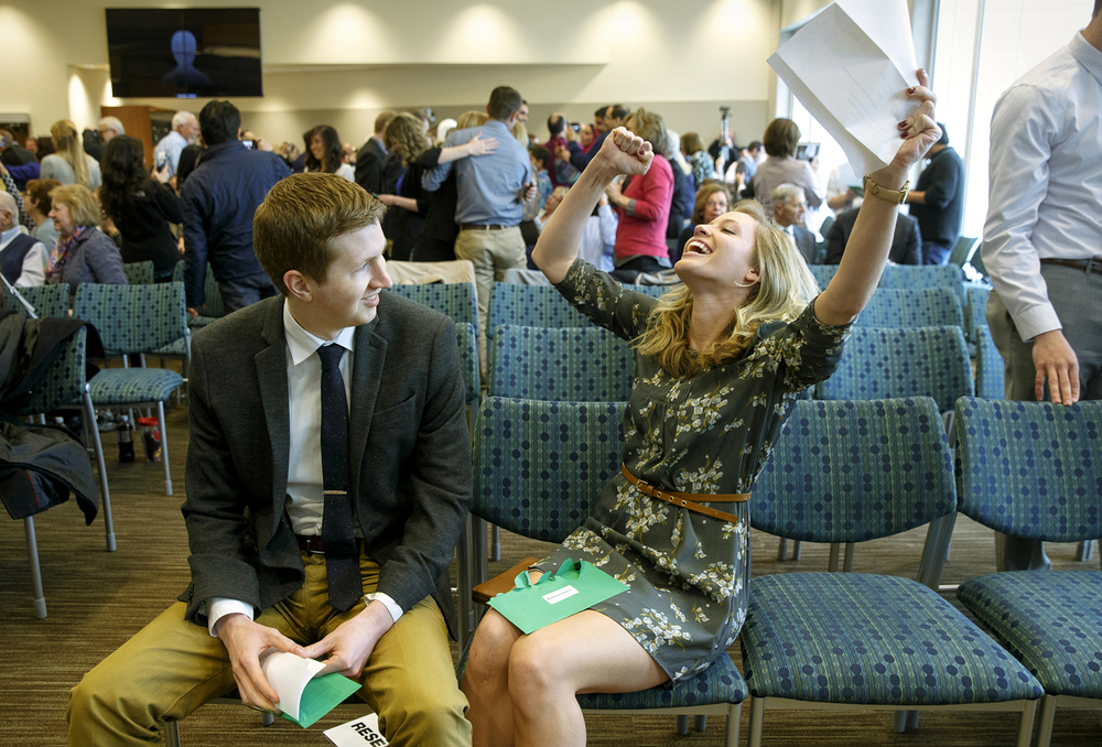 Southern Illinois University School of Medicine student Madelynn Hawkins throws her arms in the air as she discovers she is headed to Advocate Christ Medical Center in Chicago during the 2016 National Residency Match Program event at the Memorial Center for Learning and Innovation Friday, March 18, 2016.  Jordan Myhre, who later learned he is headed to Kansas City, MO, is at left. Ted Schurter/The State Journal-Register